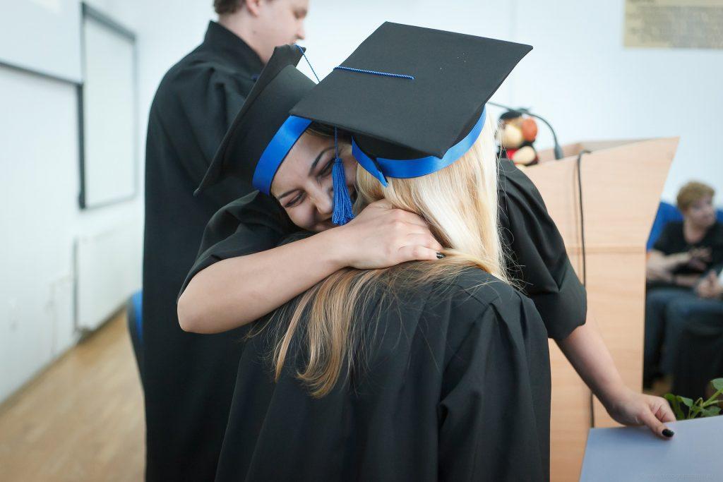 Picture of two happy college graduates.